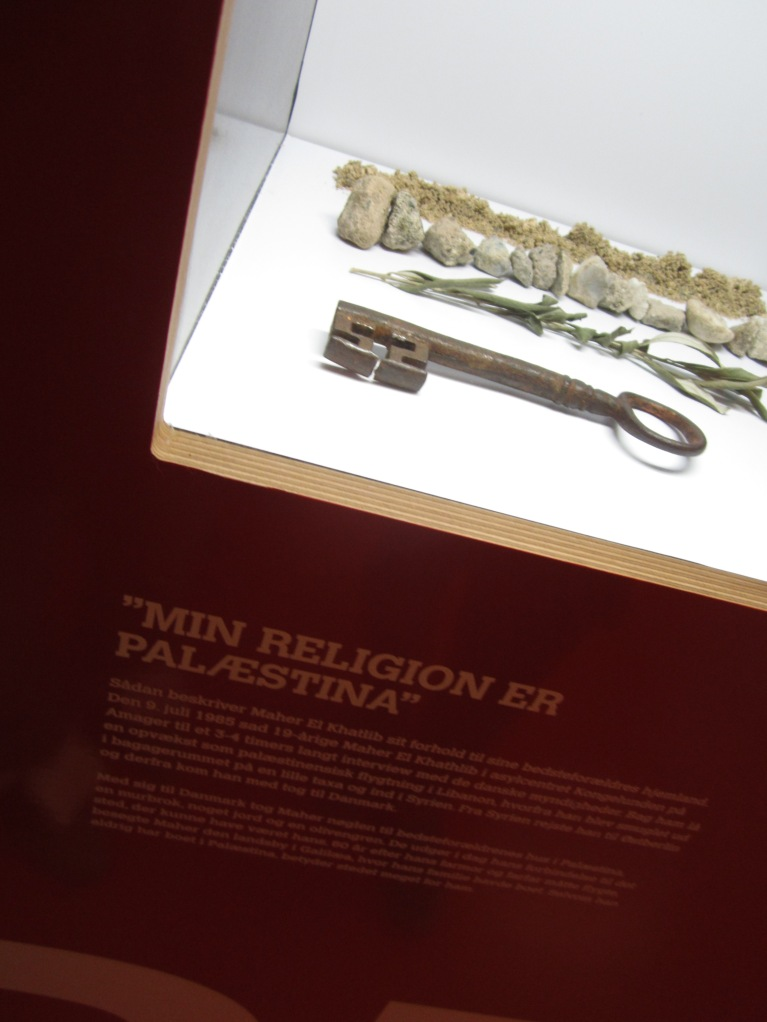 the key belongs to a Palestinian, who now live in Denmark. It is an access to his house which he believed was stood still by the time he left Palestina. What is home? Home is where your hearth stays.